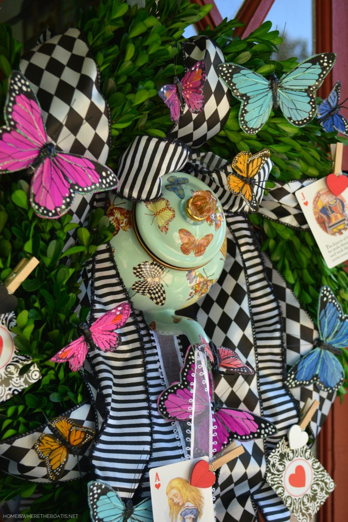 Teapot wreath for Mad Tea Party | ©homeiswheretheboatis.net #teaparty #aliceinwonderland #wreath #butterflies
