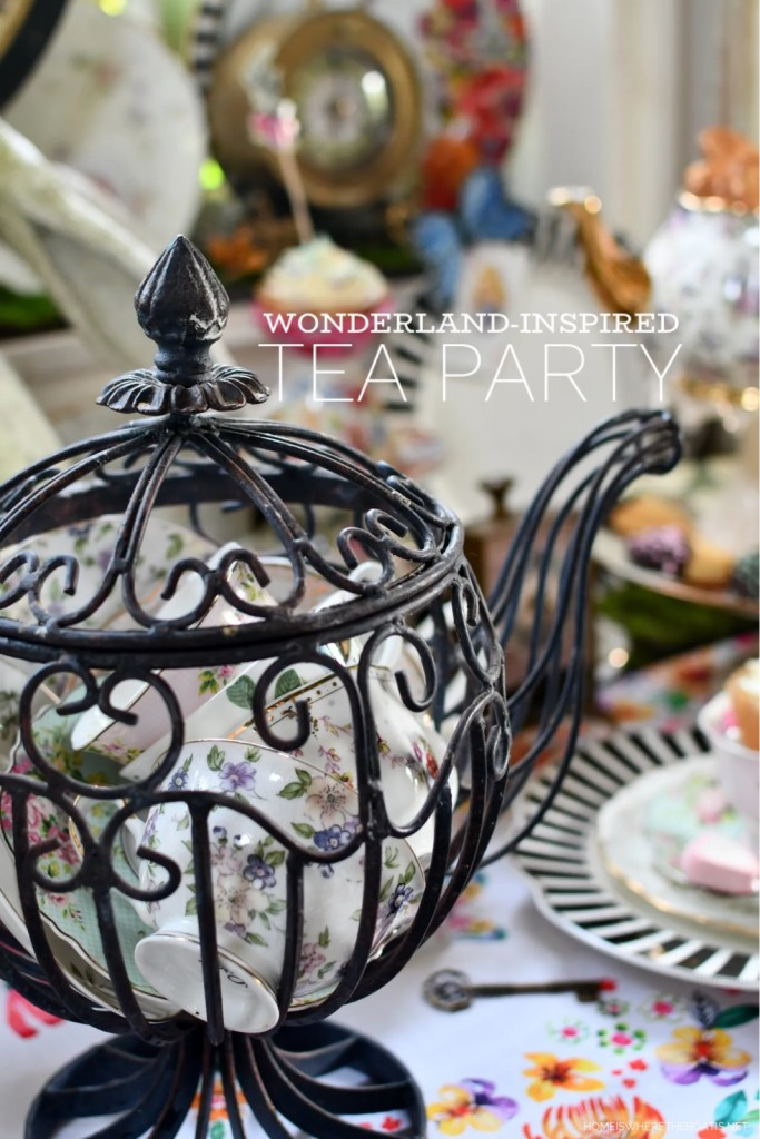 Alice in Wonderland inspired table and Mad Tea Party | ©homeiswheretheboatis.net #teaparty #aliceinwonderland #wreath #butterflies #tablescape