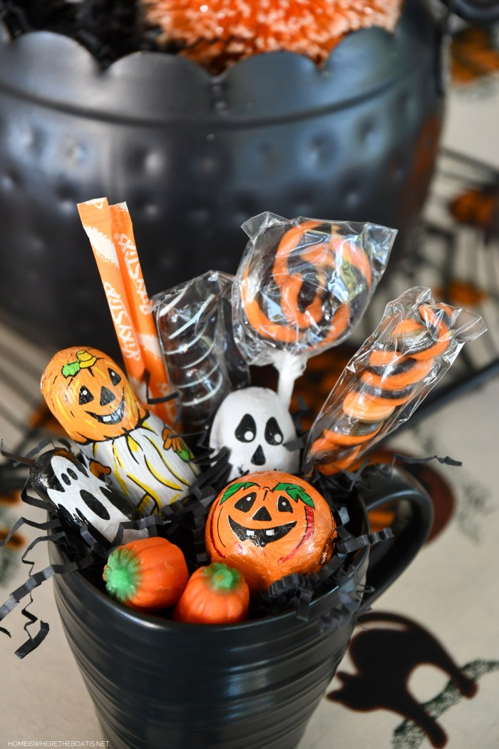 Halloween treats in mug for a Happy Haunting Tablescape | ©homeiswheretheboatis.net #halloween #tablescape