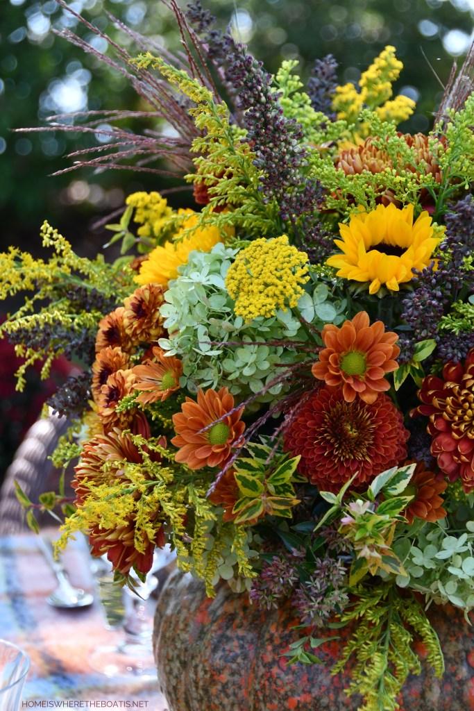 DIY Blooming Pumpkin Using a Shortcut + Alfresco Fall Table   ©homeiswheretheboatis.net #fall #pumpkin #flowerarrangement #DIY #alfresco #tablescape #lake