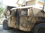 A Humvee hit by a suicide bomber.