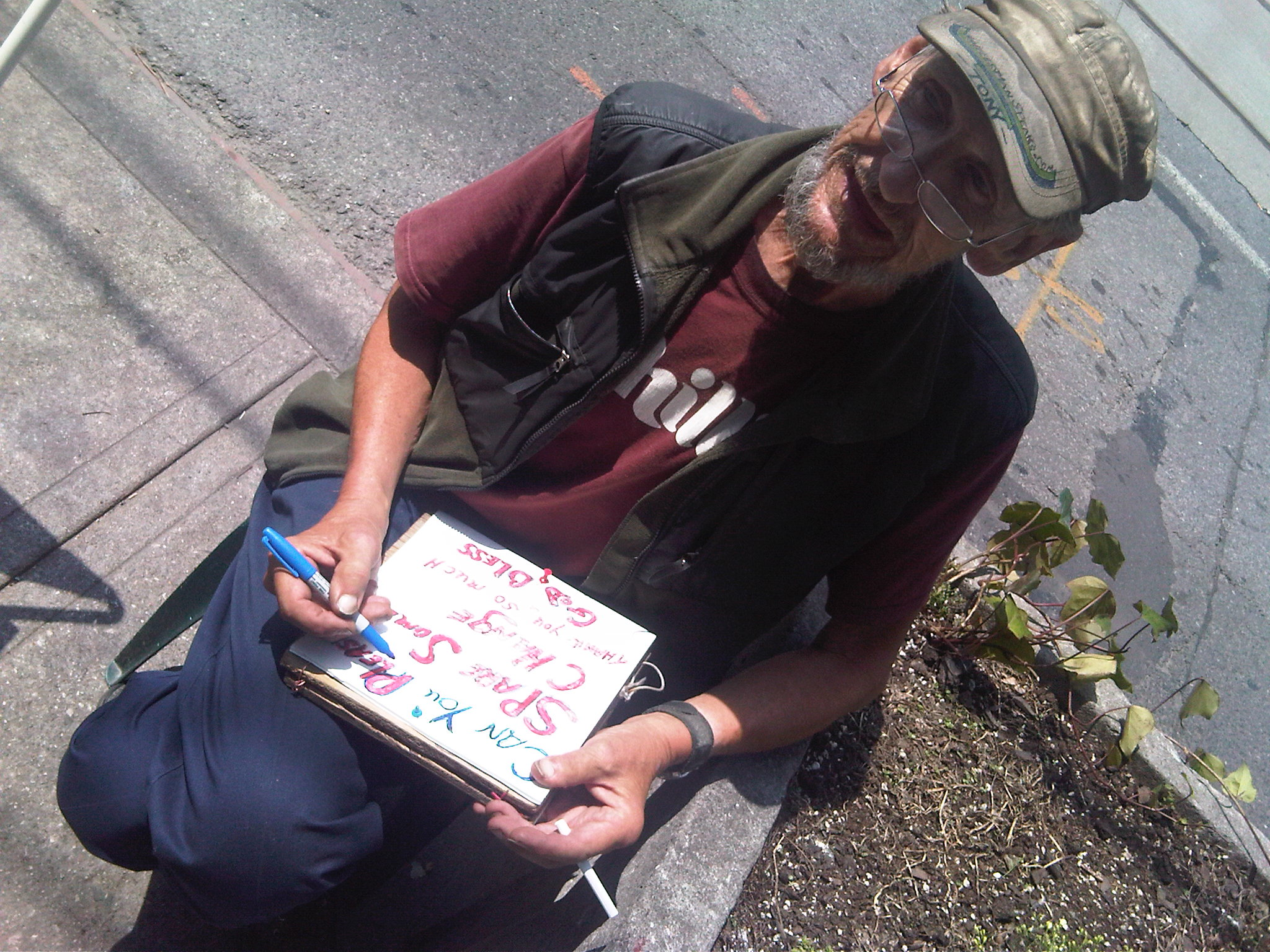 Tony brightening up his sign - Aug 7 2009