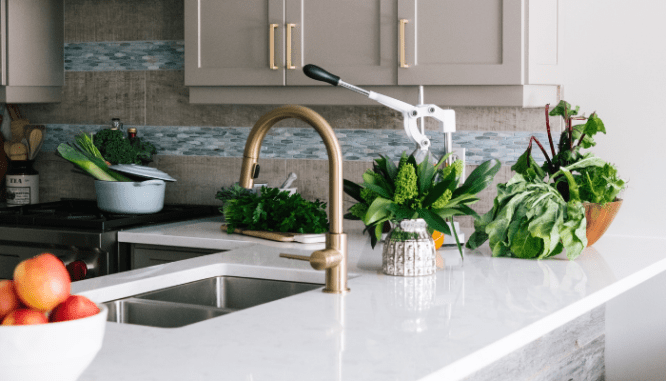 A kitchen with brass fixtures that are in style.