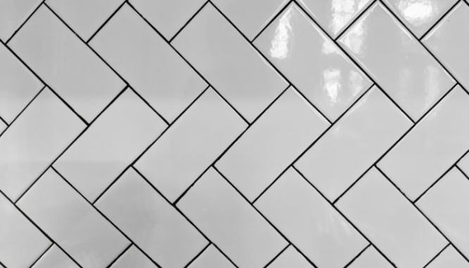 A herringbone pattern of subway tiles.