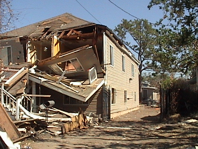 A house with hurricane damage that will require an insurance claim.