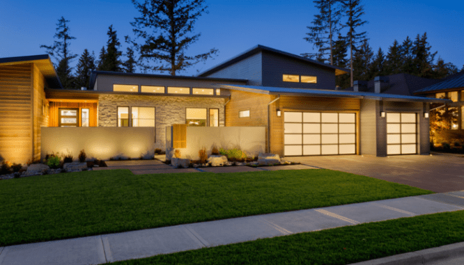 A house with lighting that increases curb appeal.