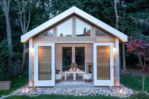 A studio shed addition used as a backyard office.