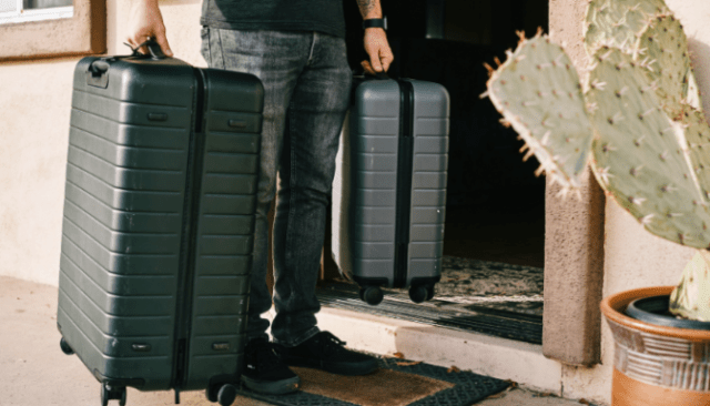 An image of a man with suitcases who has prepared a home emergency evacuation plan.