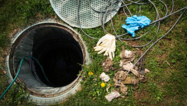 A septic tank that will be inspected near a house.