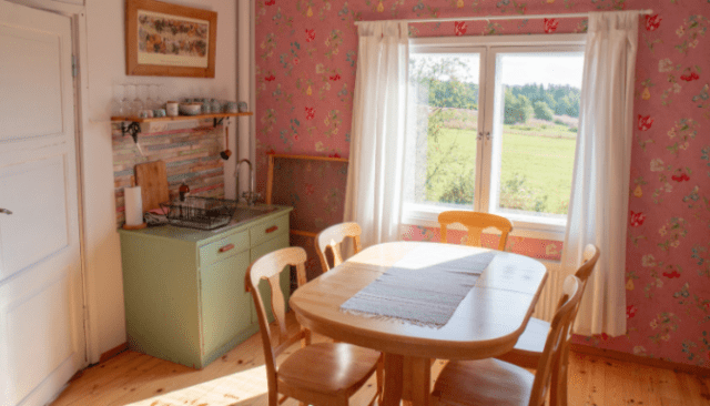 An image of a pink kitchenette.