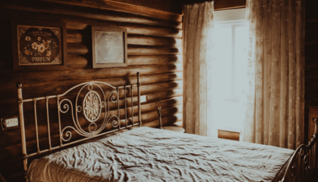 An image of a bed in a house to depict money saving tips for buying a home.