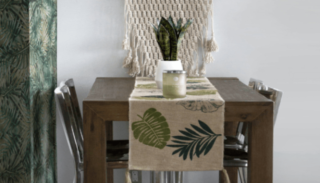 A table with palm tree motifs that fit the tropical modern decor.