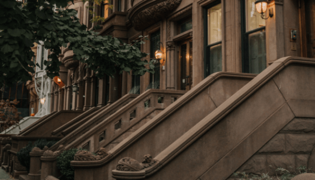 An image of a Brownstone on a street to depict what a Brownstone is.