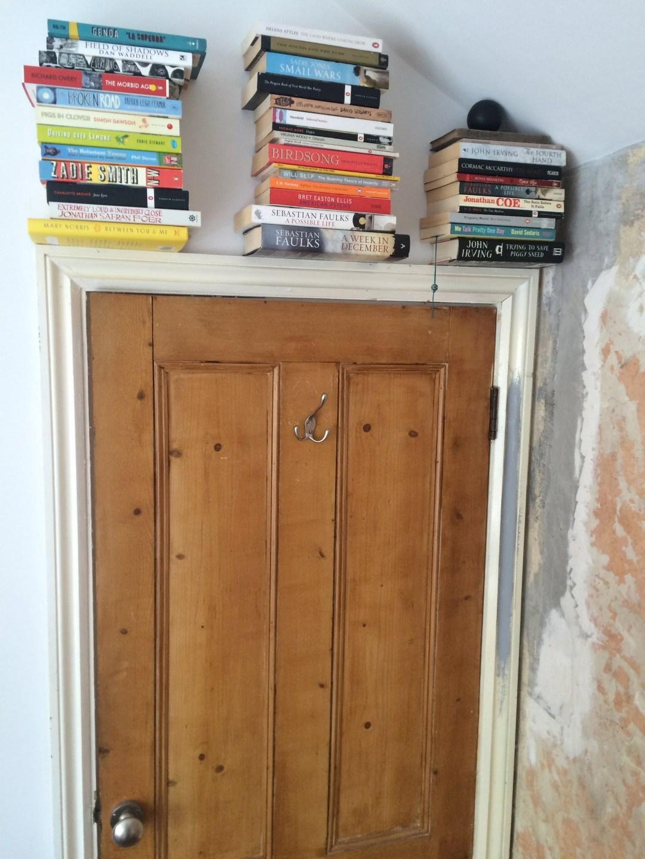 Invisible bookshelf over door
