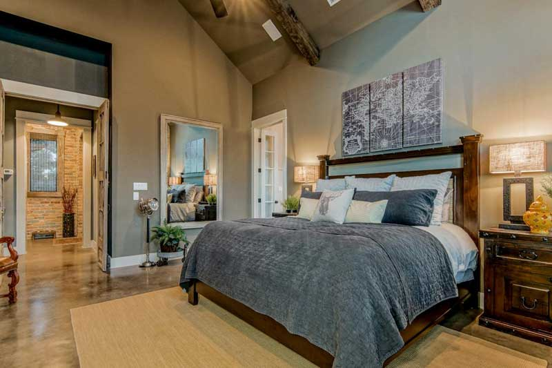 Eclectic Bedroom with Concrete Floors