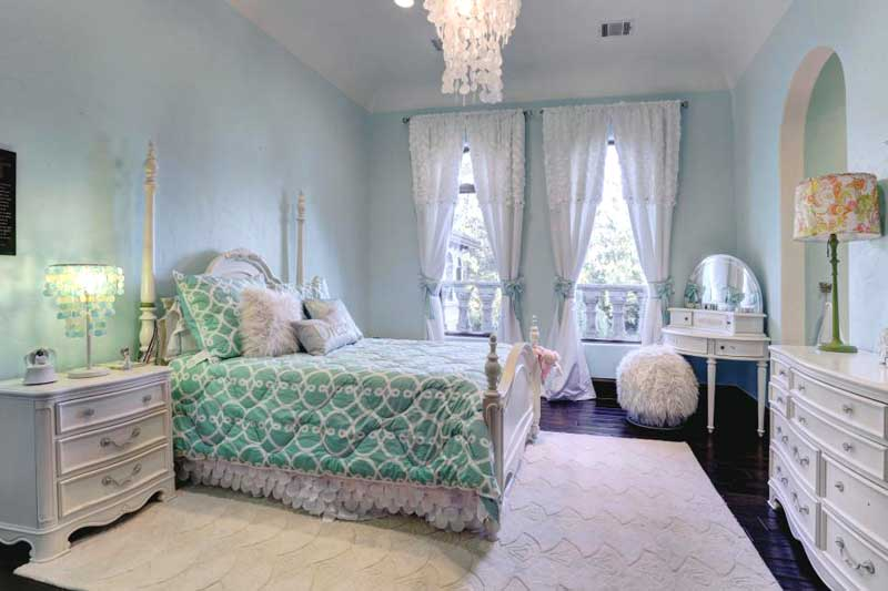 Blue and White Bedroom With White Bed