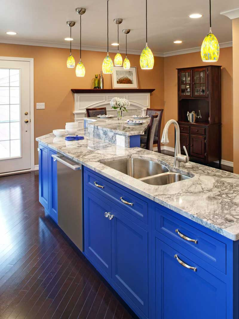 Bright Blue Kitchen Island With Marble Countertops