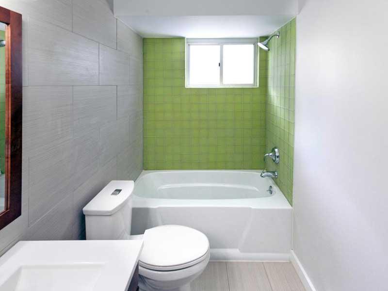 Bathroom with Green Tile Backsplash