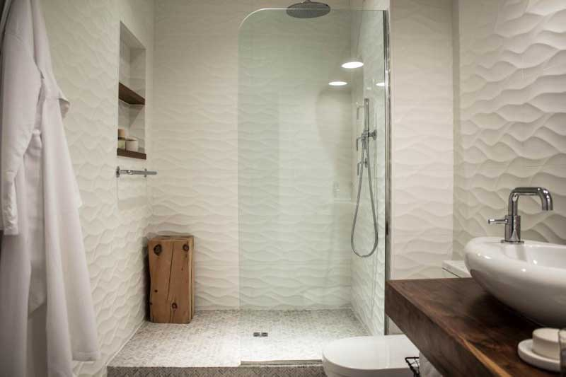 Bathroom with Rippled Tile Wall