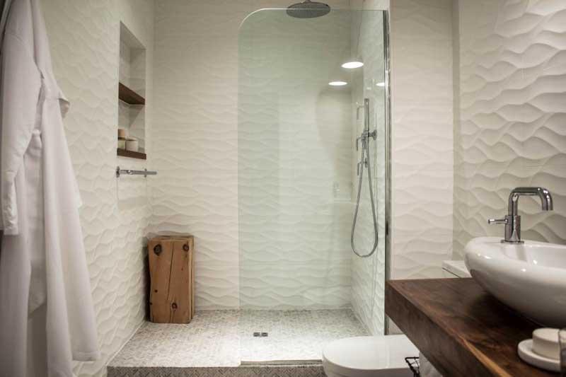 Bathroom with Rippled Tile Wall