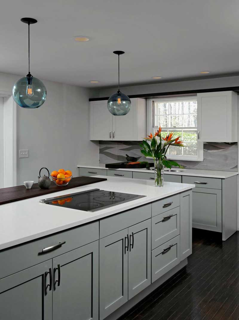 White Kitchen Island with Globe Lighting