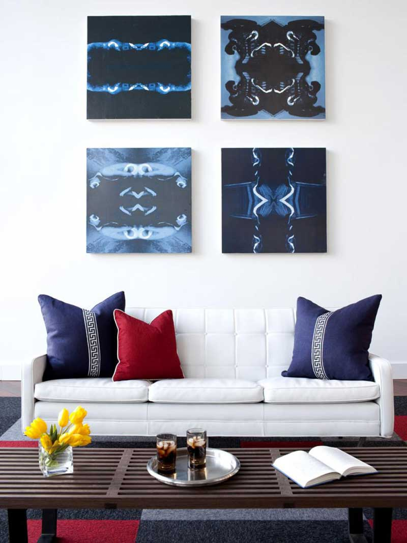 White Living Room With Blue Wall Art