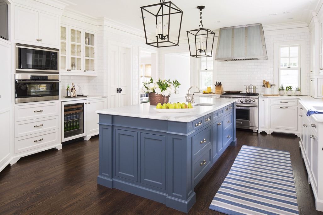 White Kitchen With Dark Wood Floors. Kitchen With Box Pendant Lights Over  Blue Kitchen Island