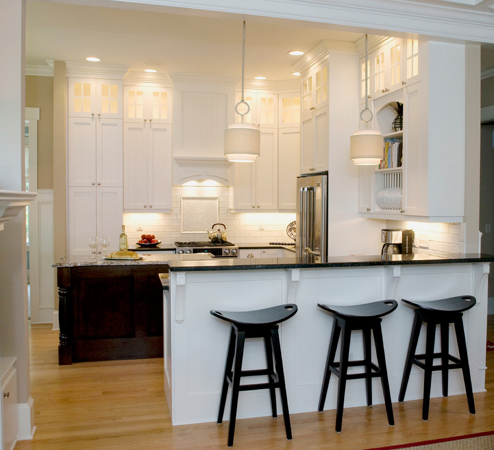 Small White Kitchen With Under Cabinet Lighting. Kitchen With Black Bar  Stools And Drum Shade