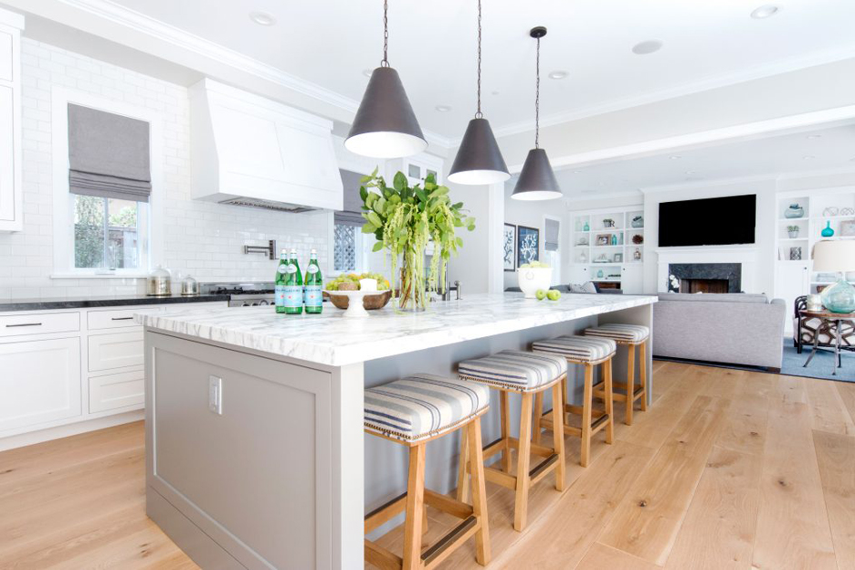 White Kitchen With White Tile Backsplash And Backless Bar Stools. Kitchen  With Contemporary Pendant Lights
