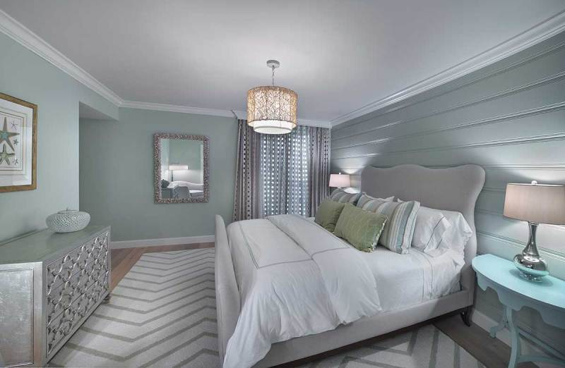 small grey bedroom with drum shade pendant lighting