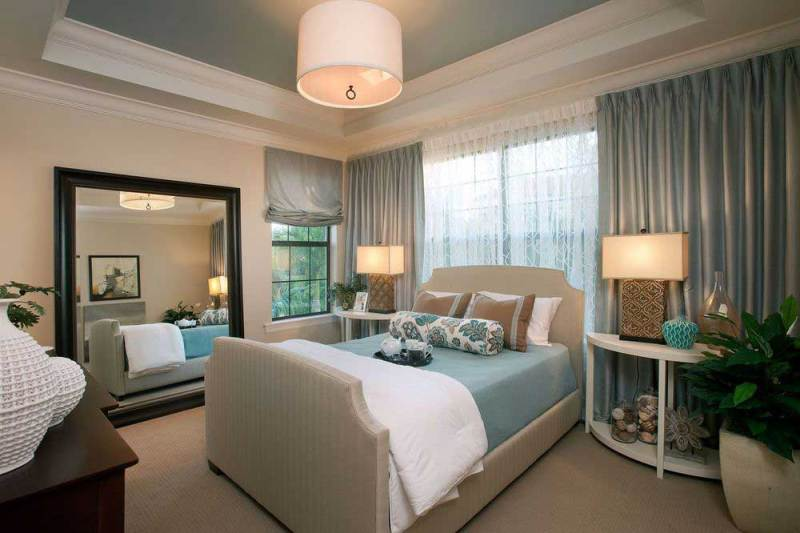 bedroom with drum pendant lighting
