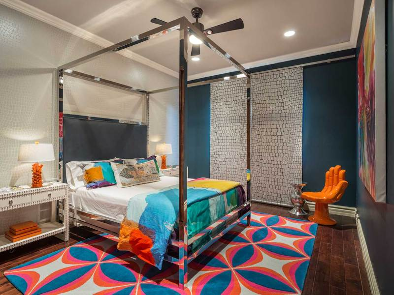 colorful bedroom with ceiling fan lighting