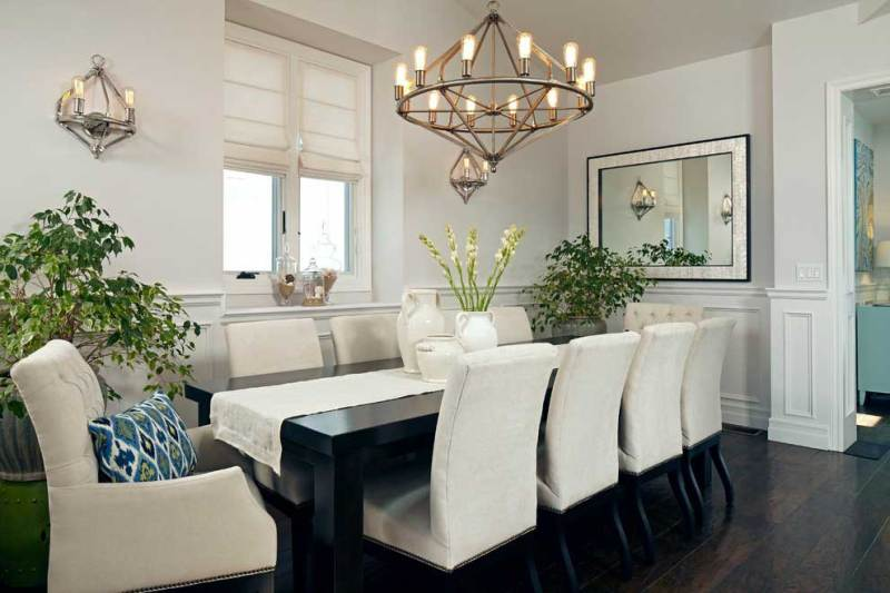 transitional dining room with industrial glass chandelier