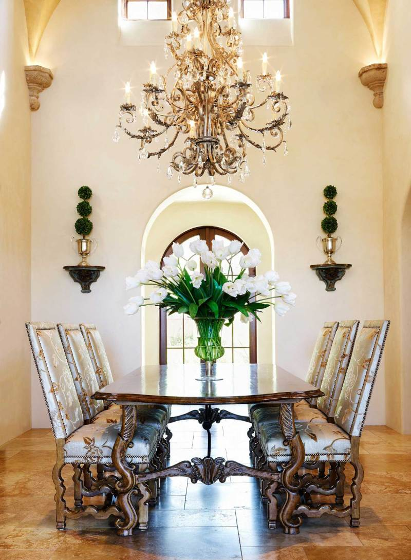 mediterranean dining room with candle chandelier