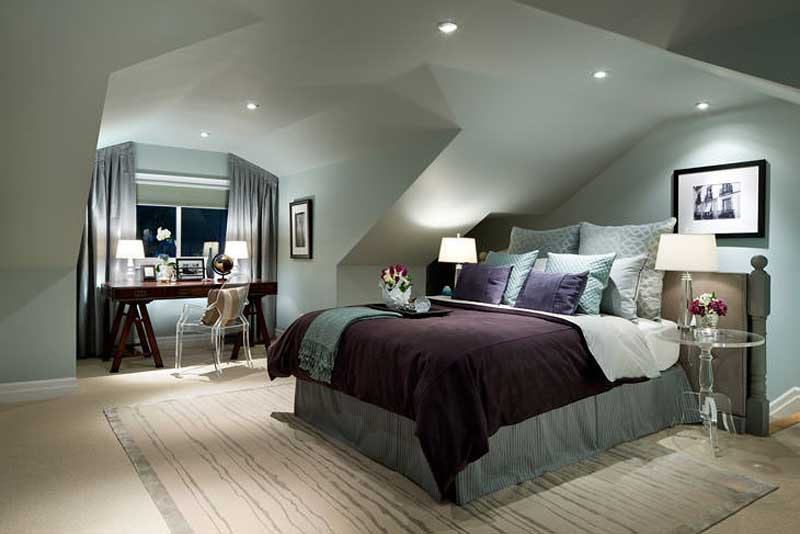 bedroom with table lamps and recessed ceiling lights