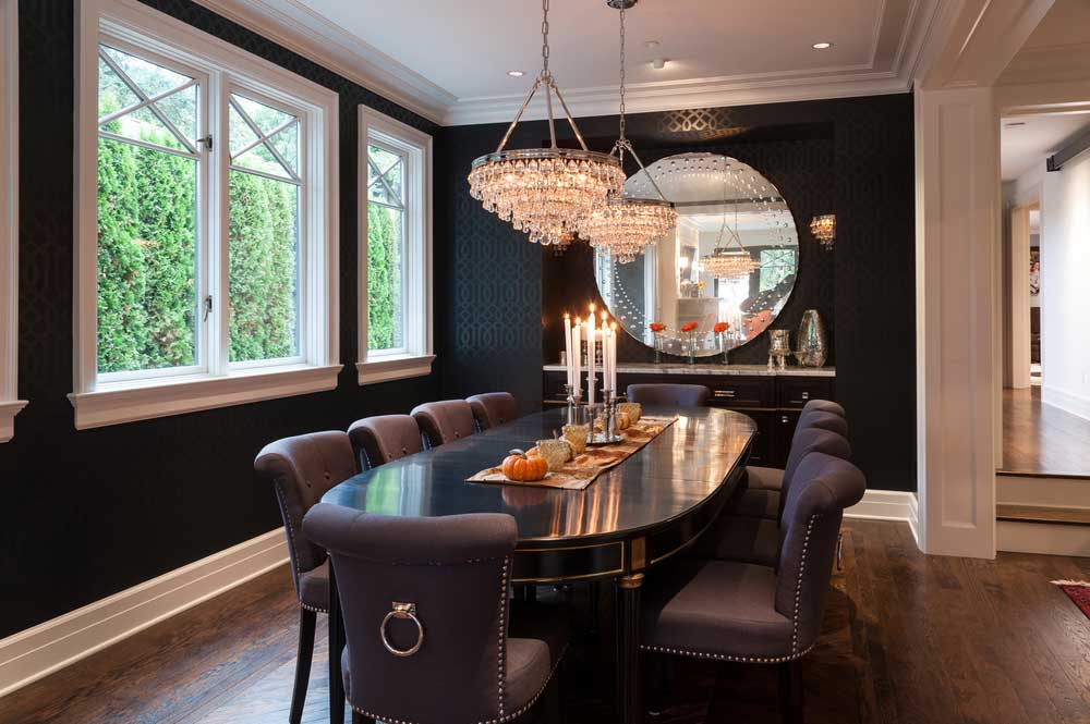 Black Dining Room With Crystal Chandeliers And Candle Table Lamps