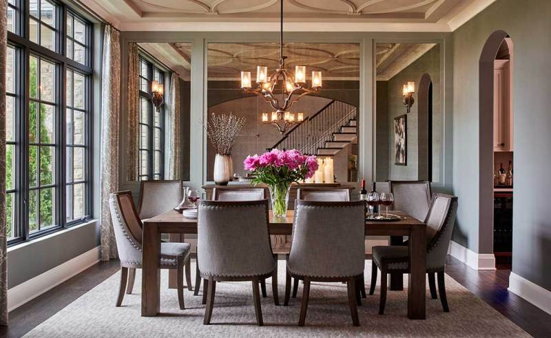 gray formal dining room with chandeliers
