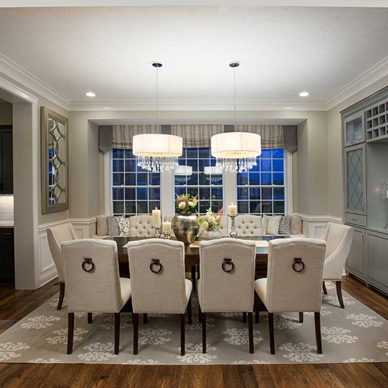 formal dining room with 2 chandeliers