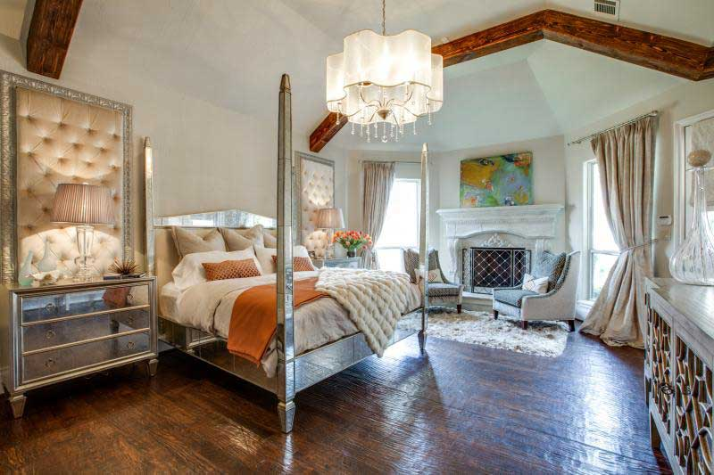 traditional master bedroom with chandelier and table lamps