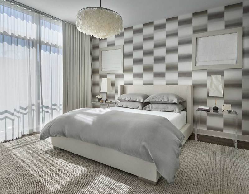 modern master bedroom with round capiz chandelier