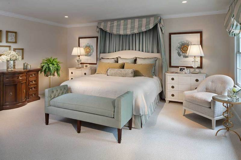stunning master bedroom with table lamps