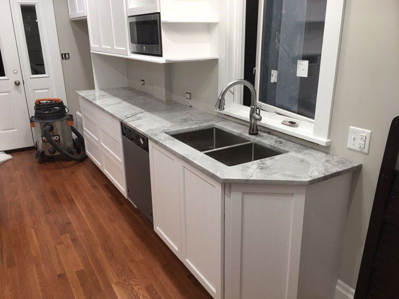 White kitchen with super white granite countertops