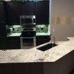 Black cabinets with white galaxy granite