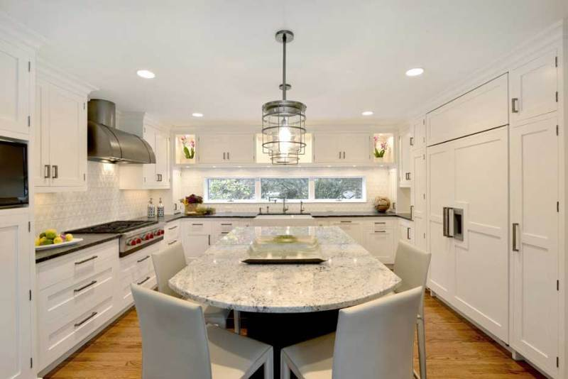 kitchen with glass industrial pendant light