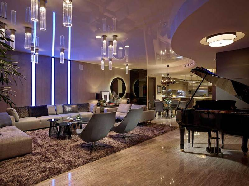 contemporary living room with glass tube ceiling light