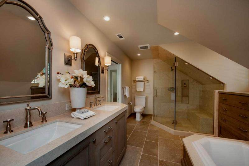 bathroom with large wall sconces