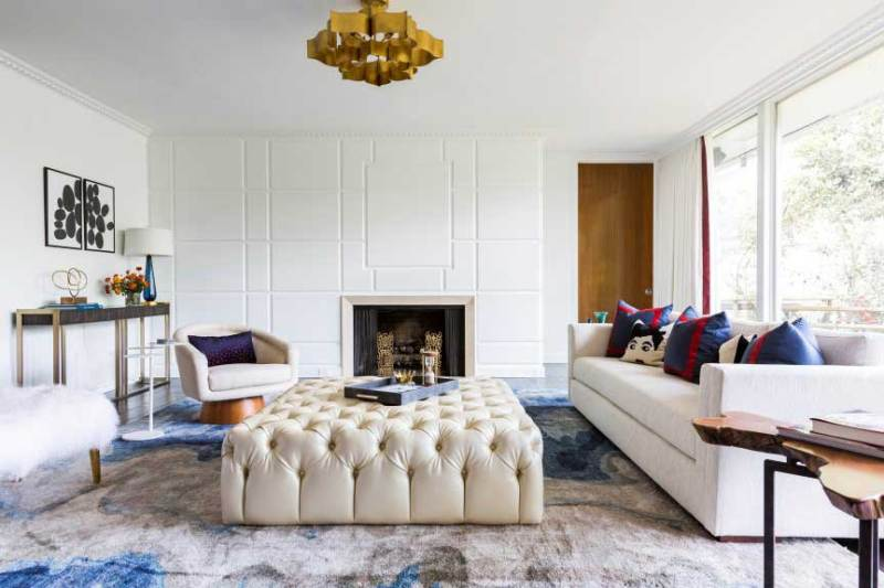 living room with gold pendant ceiling light