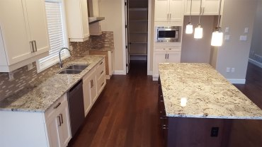 White kitchen cabinet with arctic white granite countertops