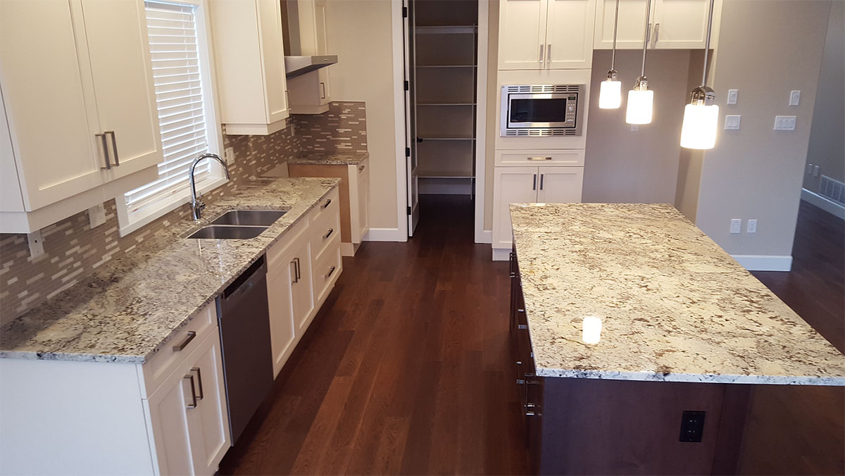Great White Kitchen Cabinet With Arctic White Granite Countertops