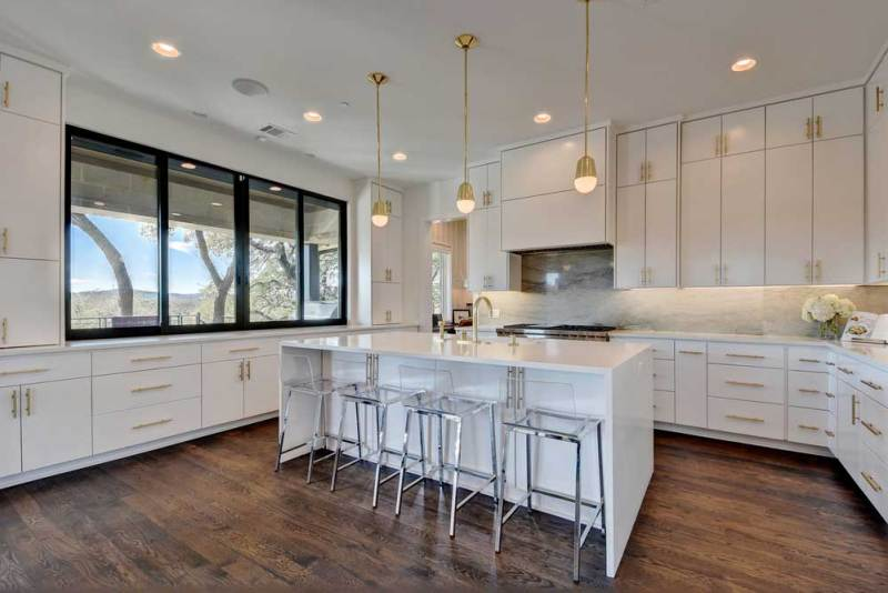 kitchen with modern gold pendant lights
